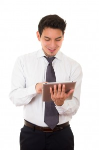 Young successful businessman with tablet, latin
