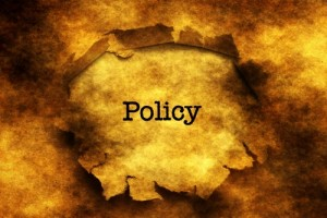 Policy text on  paper hole grunge concept
